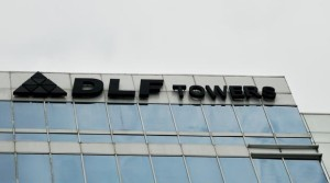DLF to sell 50% stake in 4 projects to PE firms for Rs 3,000 cr .